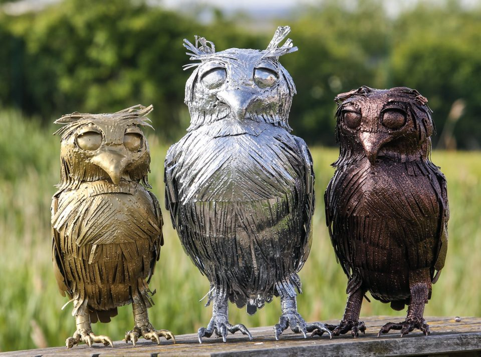 Gold, silver and bronze metal owls