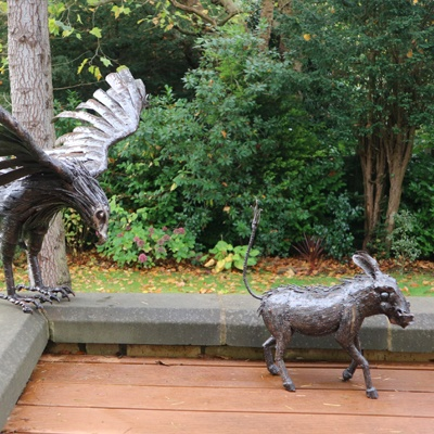 Eagle hunting Warthog Sculptures