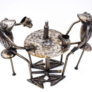 Frogs at a table